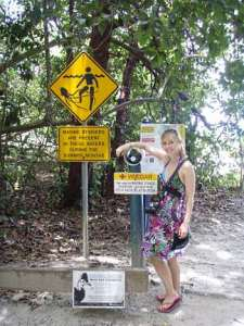Sheri by the beach sign