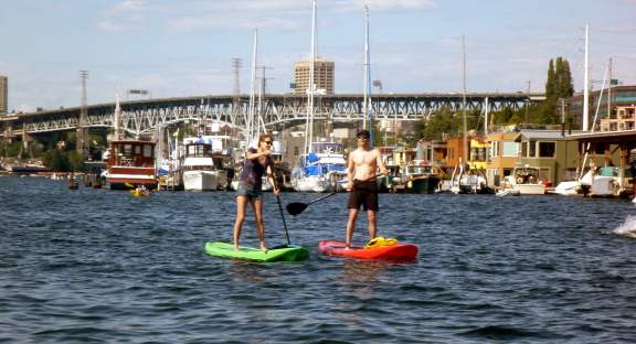 paddle boards, houseboats, and a bridge