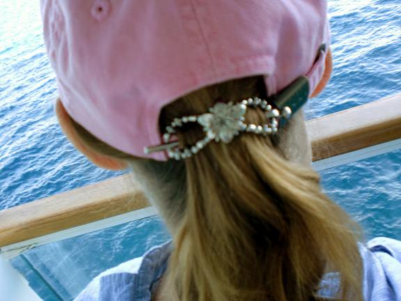 wearing flexi clips on pony tail through a hat