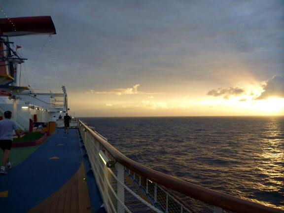 sun rising over Carnival Breeze in the north Atlantic ocean