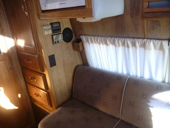 couch in a camper van converts to a bed