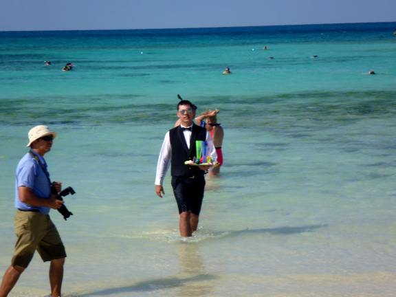 beach waiter on Great Stirrup Cay