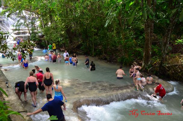 crowds of people climbing Dunns River Falls