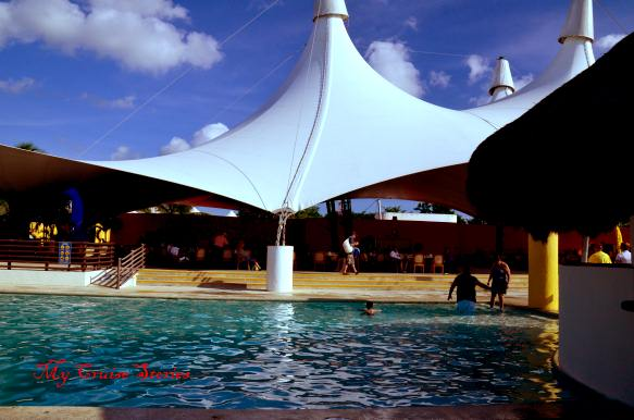 pool and restaurant at Playa Mia