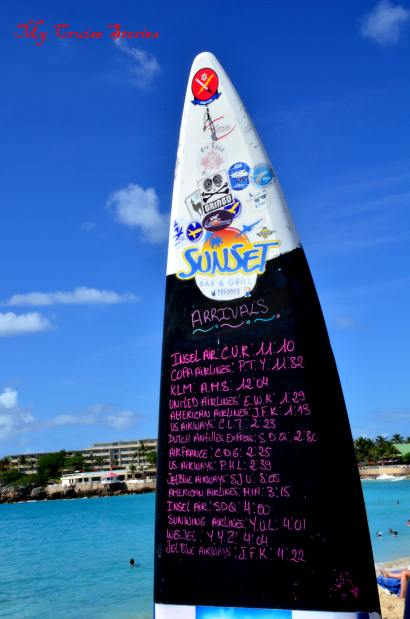 sign posted at Maho Beach listing the airplane schedule for the day