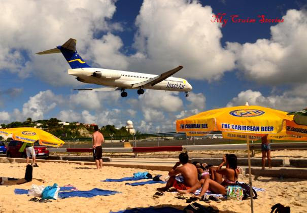 the beach where the airplanes fly just overhead