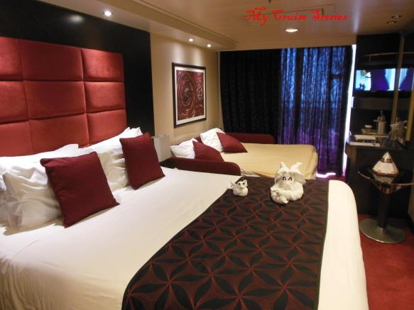 Sleep two extra people in this 4-person balcony room with double couch bed on the MSC Divina