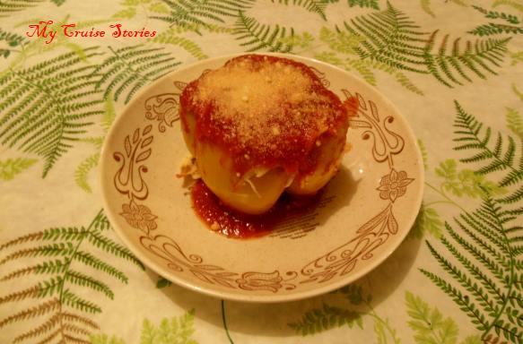 baked stuffed pepper topped with cheese and tomato sauce