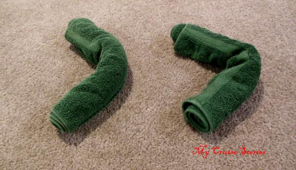 roll two hand towels for crocodile legs