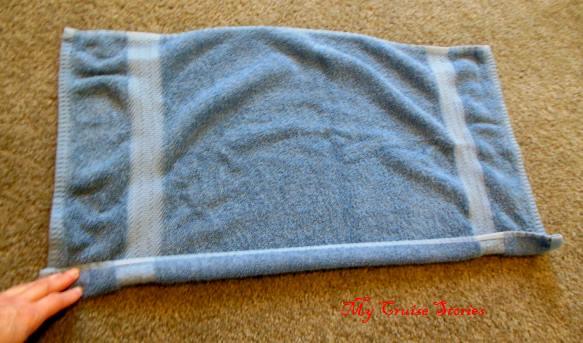 folding a towel into dragon wings