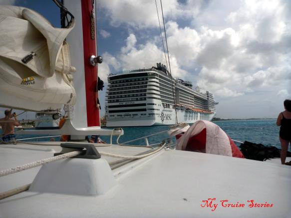cruise ship and sailboat