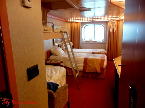 couch bed and drop down bunk make room for 4 passengers in ocean view stateroom