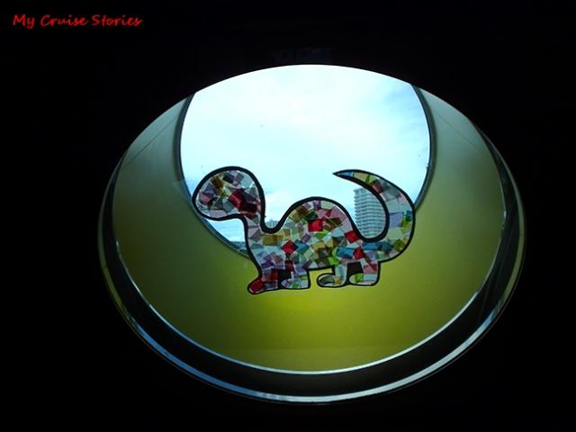 dinosaur in a porthole