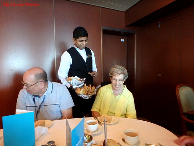 waiter serves afternoon tea