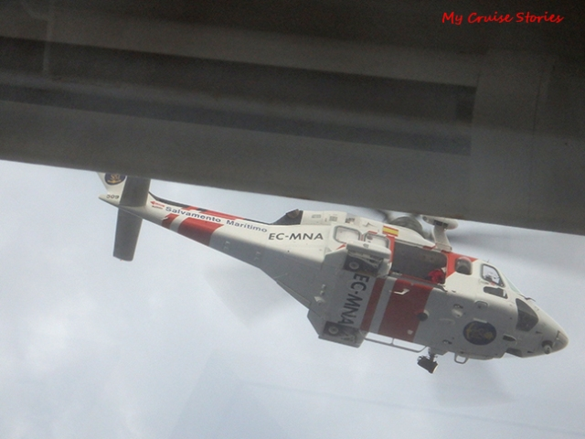 looking up at helicopter from cruise ship balcony