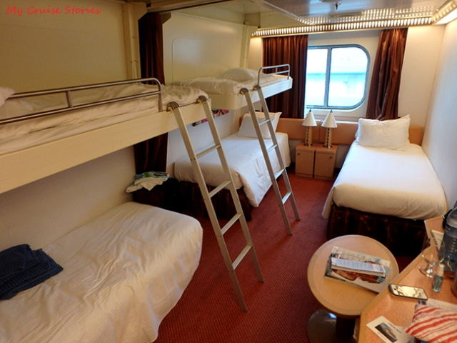 five people in a cruise ship cabin